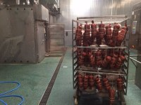 Highly filled coating in the smoking department of a meat processing plant
