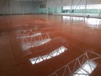 Concrete floor with color surface hardeners (freshly laid)